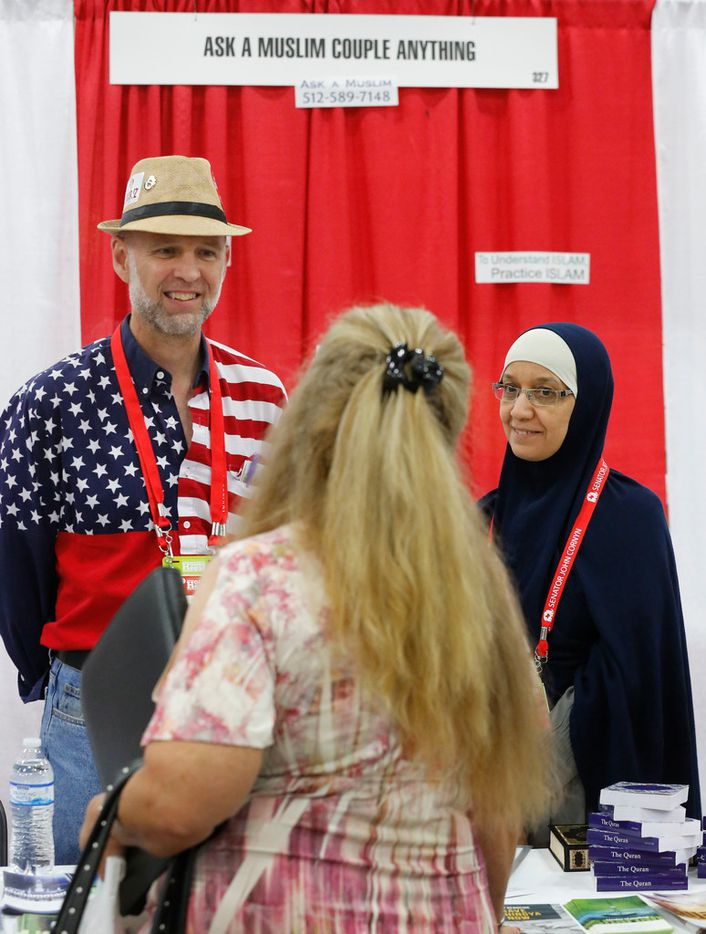 "Aicha and Clay Smith staff the ""Ask a Muslim Couple Anything"" booth in the exhibit hall at the 2018 Texas GOP Convention held at the Henry B. Gonzalez Convention Center in downtown San Antonio, Texas on Friday, June 15, 2018. (Louis DeLuca/The Dallas Morning News)"