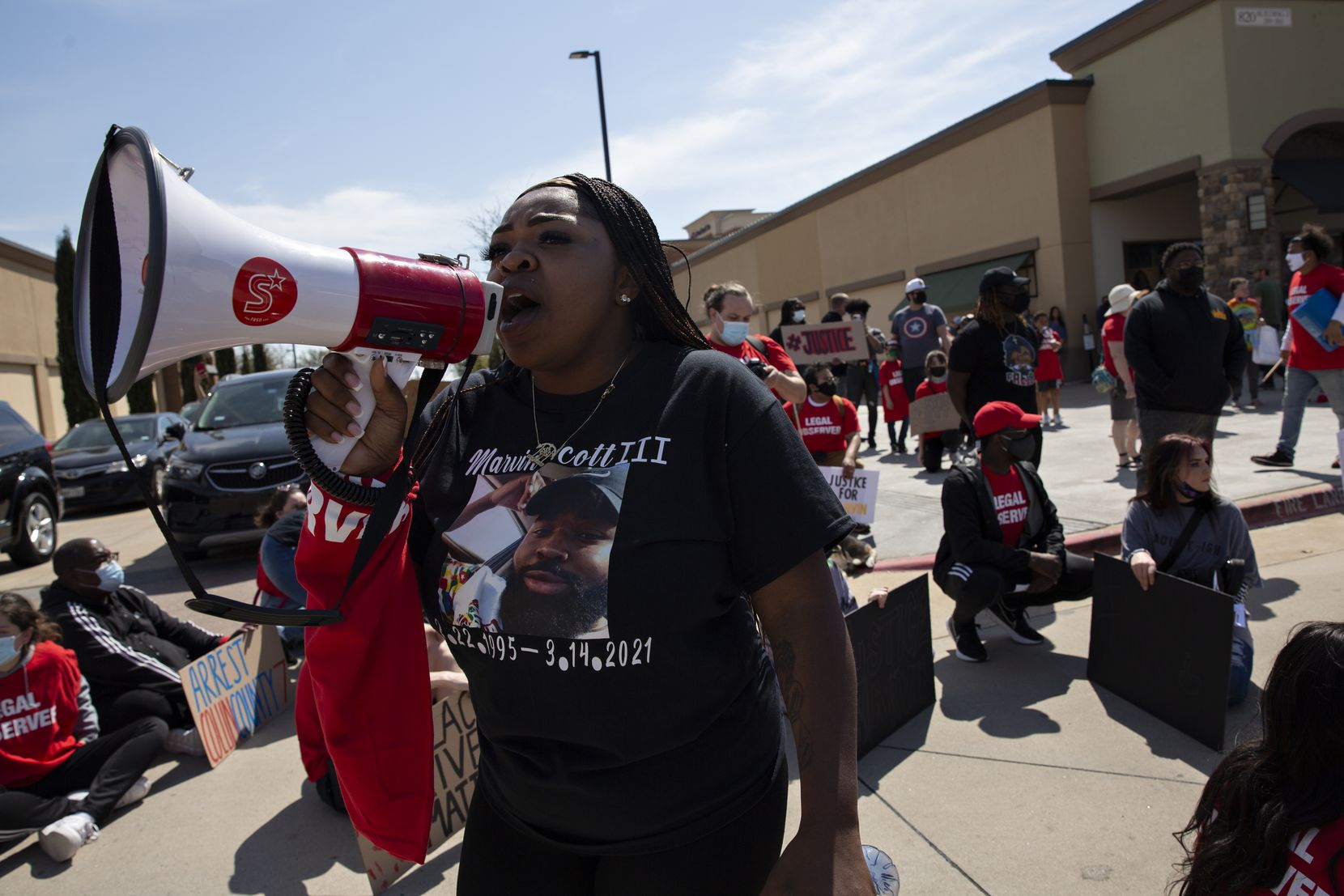 LaChay Batts encourages demonstrators to not engage with agitators frustrated with the traffic caused by a march through the Allen Outlets on Sunday, March 21, 2021. The march was organized to inform the community and demand justice for her brother Marvin Scott III, who died a week prior while in custody at the Collin County Jail on March 14, 2021. (Shelby Tauber/Special Contributor)