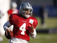 Dallas Cowboys quarterback Dak Prescott (4) runs up the field after the catch during training camp at the Dallas Cowboys headquarters at The Star in Frisco, Texas on Friday, August 21, 2020.