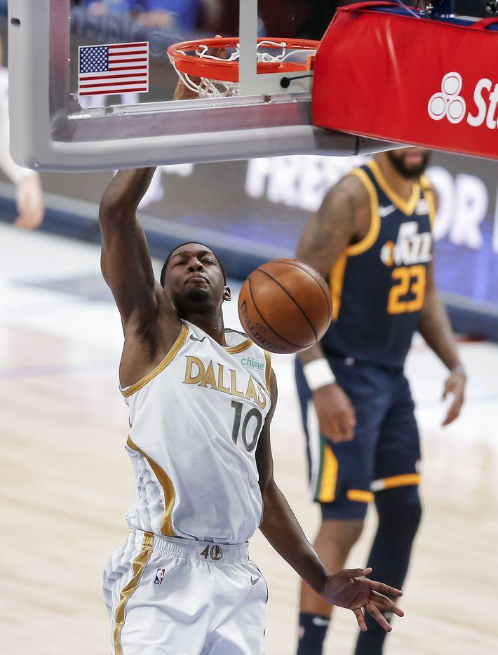 Dallas Mavericks forward Dorian Finney-Smith (10) dunks during the second half of an NBA basketball game against the Utah Jazz in Dallas, Monday, April 5, 2021. (Brandon Wade/Special Contributor)