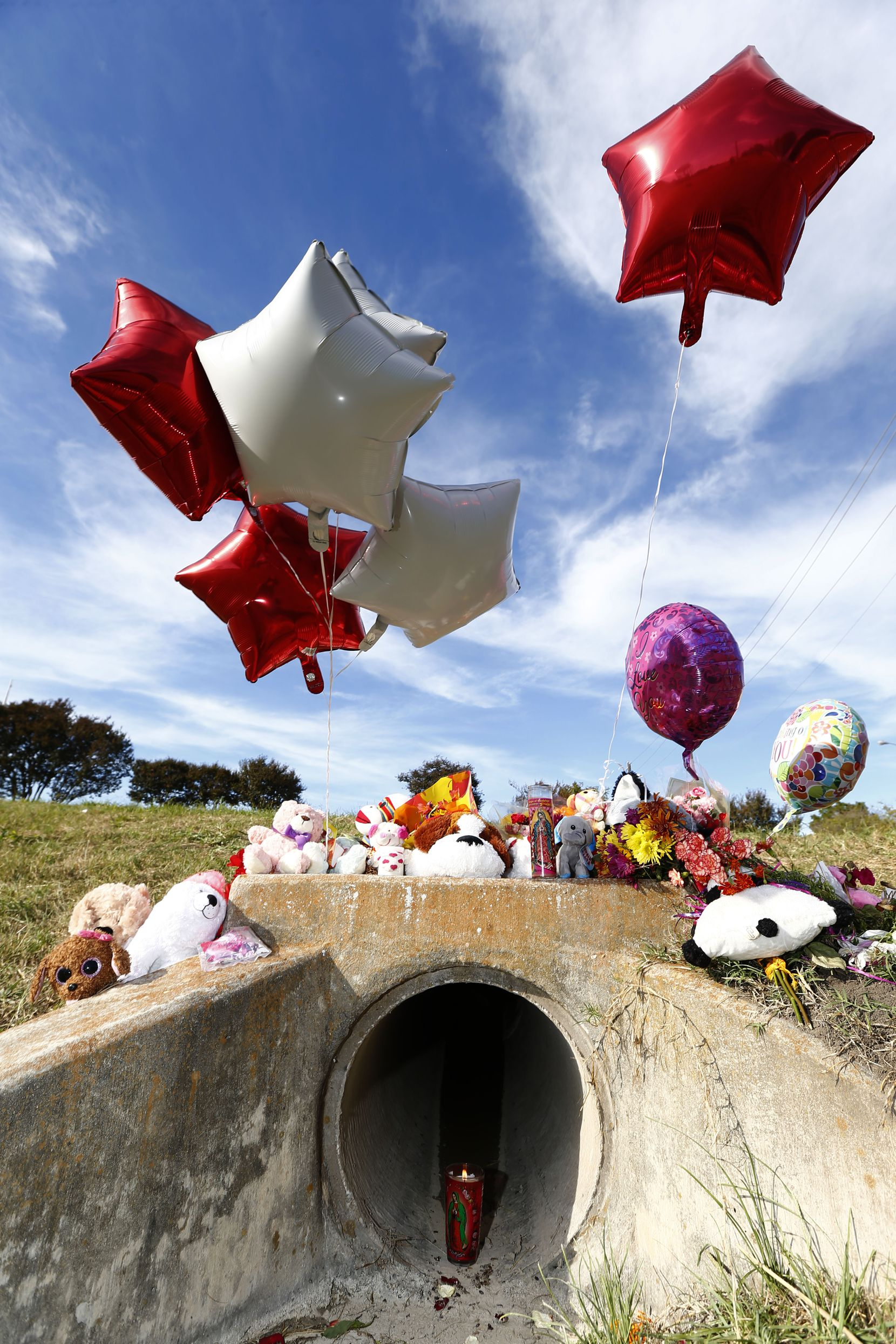 A memorial in the area where the body of a small child was found Sunday morning during the search for a missing 3-year-old girl.