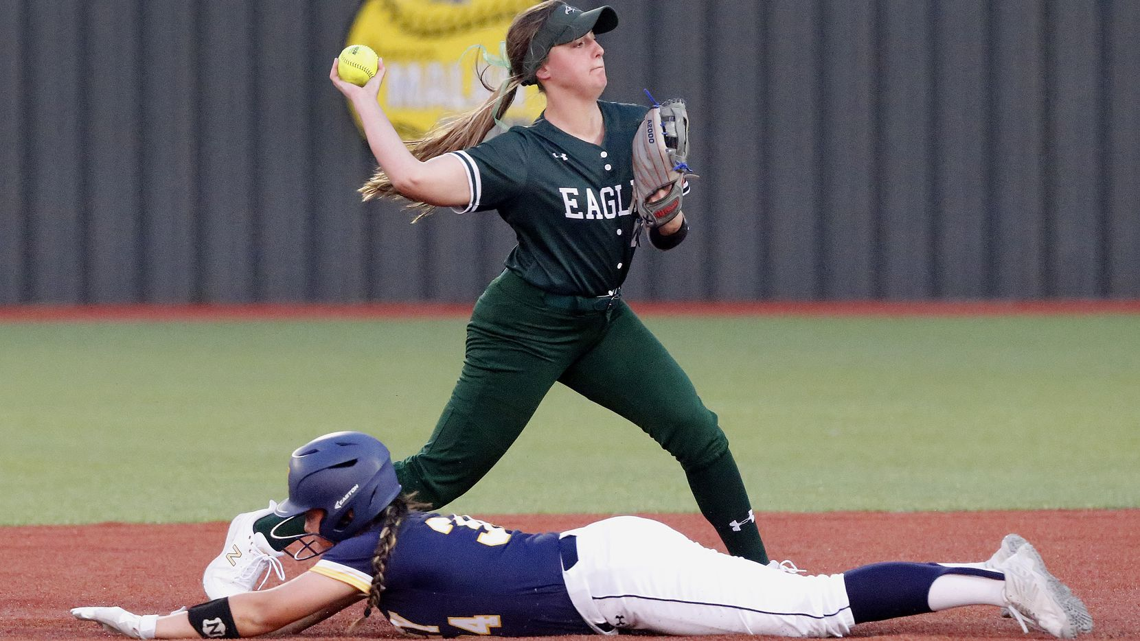 Prosper shortstop Abbey Beasley makes the throw for a double play during the second inning of a 15-0 win over McKinney on Tuesday. Beasley hit two of Prosper's six home runs in the game. (Stewart F. House/Special Contributor)