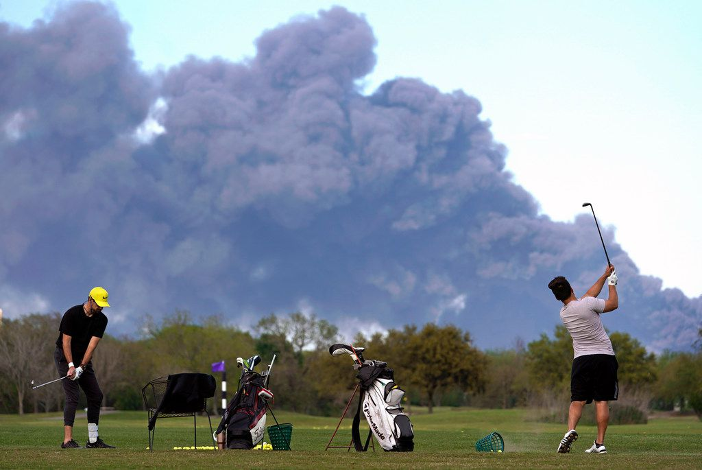 Golfers practiced at the Battleground Golf Course driving range as a chemical fire at Intercontinental Terminals Company sent dark smoke over Deer Park earlier this week.