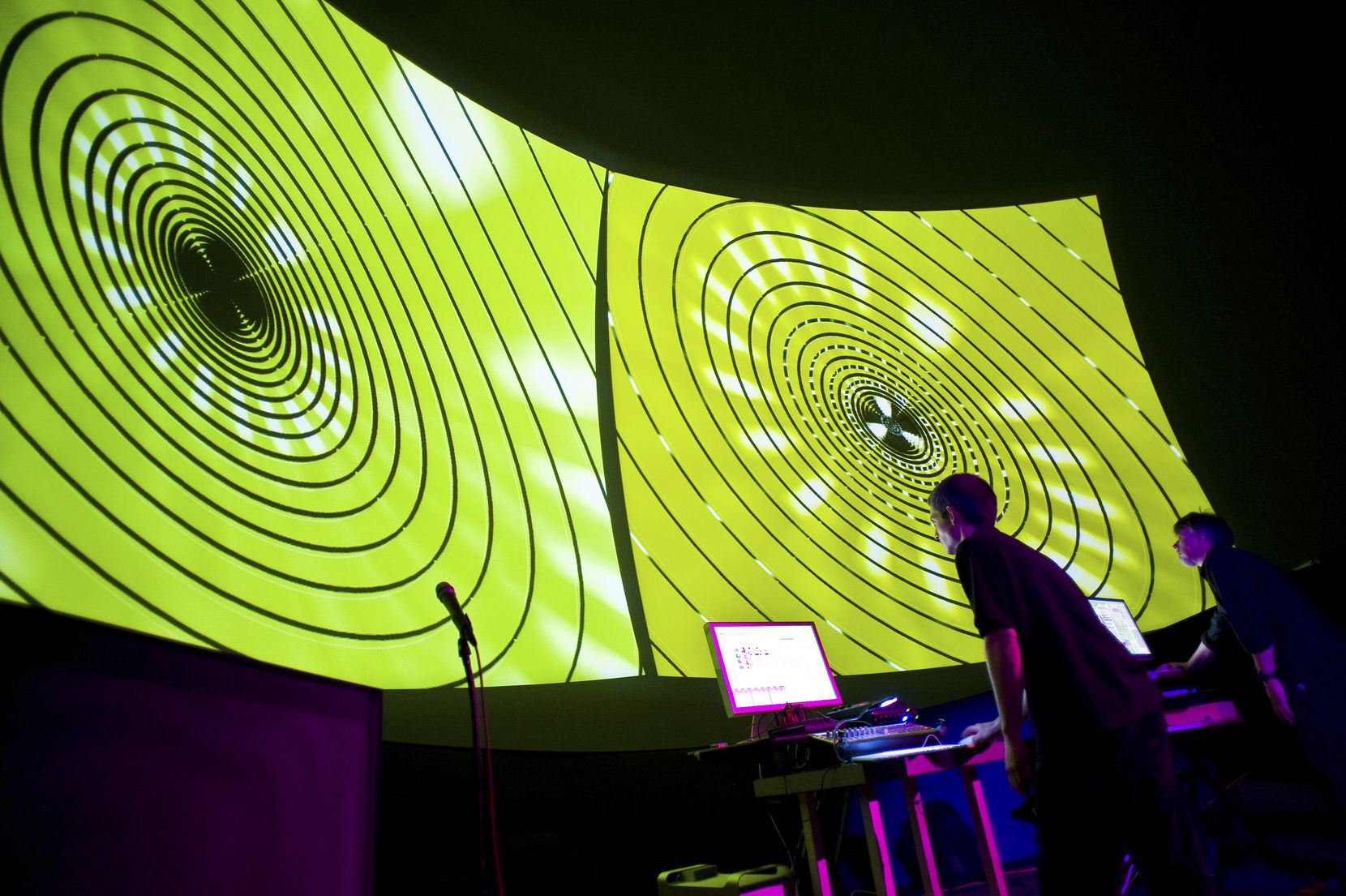 A 2009 photo of NoiseFold (Cory Mercalf, left, and David Stout) performing at Gates Planetarium at the Denver Museum of Nature & Science.