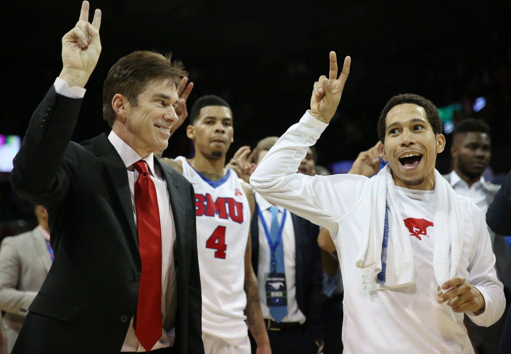 SMU interim head coach Tim Jankovich and guard Nic Moore (11) speak while participating in the school song following an NCAA season-opening basketball game between Sam Houston State and SMU at Moody Coliseum in Dallas Saturday November 14, 2015. SMU beat Sam Houston State 85-50. (Andy Jacobsohn/The Dallas Morning News)
