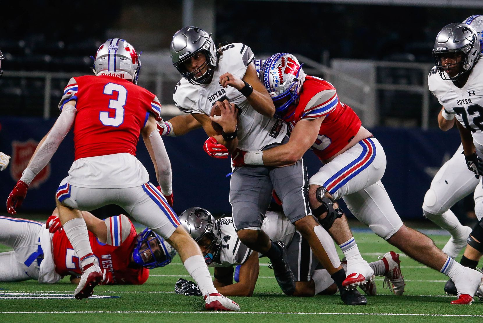 Denton Guyer's quarterback Eli Stowers (5) gets taken down by Austin Westlake's defense in the first quarter of a Class 6A Division II state championship game at the AT&T Stadium in Arlington, on Saturday, December 21, 2019. Westlake leads at halftime 14-0. (Juan Figueroa/The Dallas Morning News)