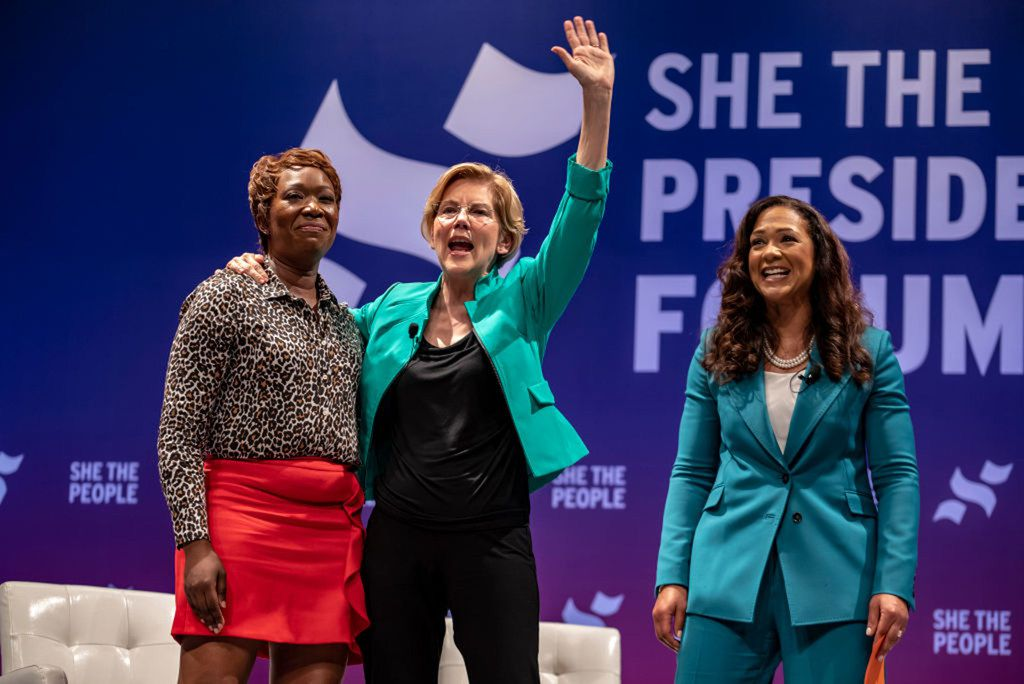 (L-R) MSNBC host Joy Reid, Democratic presidential candidate Sen. Elizabeth Warren, D-Mass.,  and She The People founder Aimee Allison address the crowd as Warren exits the stage at the She The People Presidential Forum at Texas Southern University on April 24, 2019 in Houston, Texas. Many of the Democrat presidential candidates are attending the forum to focus on issues important to women of color.