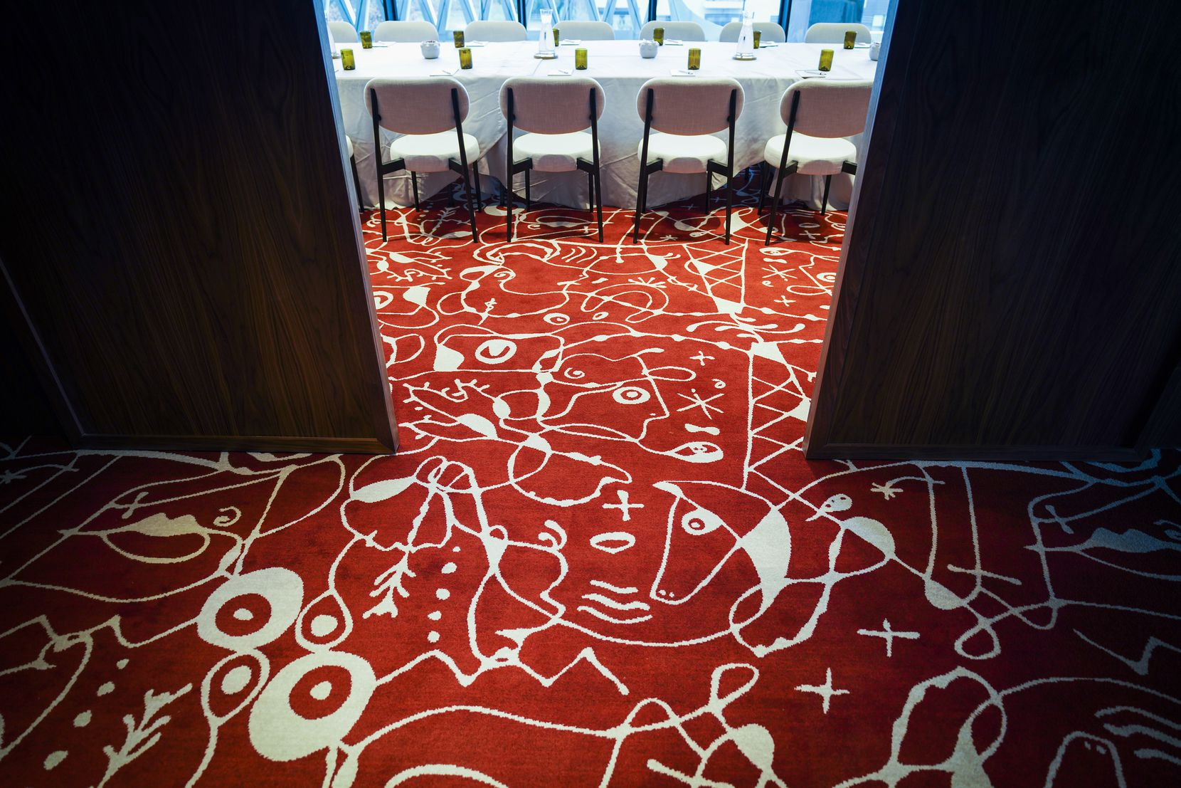 Texas themed carpet runs into a meeting room at the new Virgin Hotels Dallas.