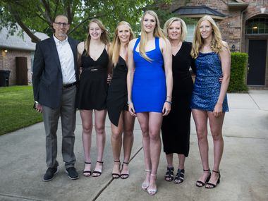 Basketball player Lauren Cox (center) poses for a photo with her family outside their home in Flower Mound before the 2020 WNBA draft on Friday, April 17, 2020. Cox and her family stayed home for the draft because of the stay at home ordinance due to the spread of coronavirus. From left are Dennis Cox, Maddie Cox, Whitney Cox, Lauren Cox, Brenda Cox and Kaylee Cox.