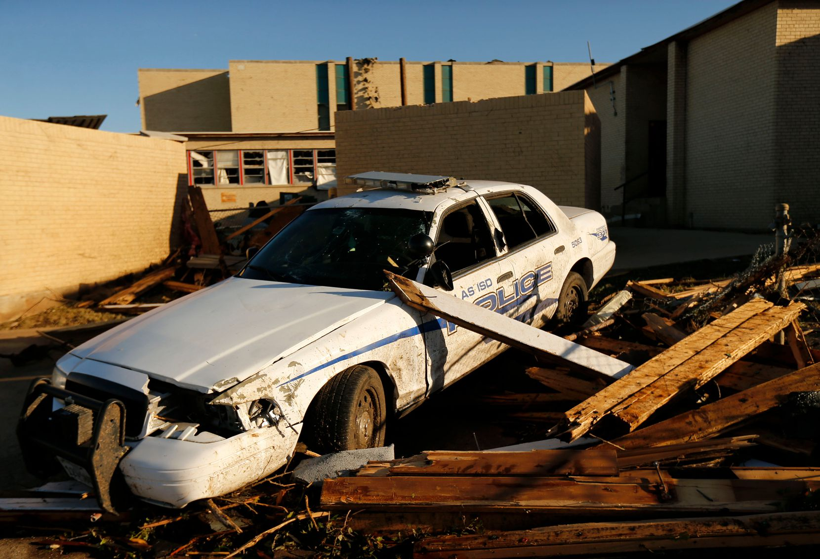A Dallas ISD school district police patrol car was destroyed by a tornado at Cary Jr. High School in Dallas, Monday, October 21, 2019.