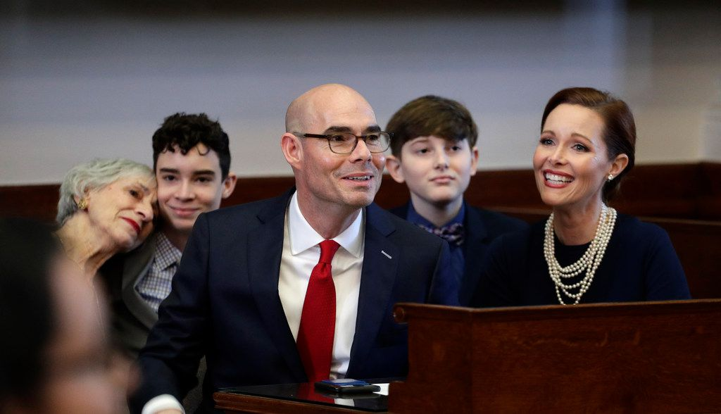 Texas House Speaker Dennis Bonnen, R-Angleton, center, shown with his family on the first day of this year's legislative session, won accolades for his management of the chamber. But this summer, a secret meeting with an intraparty foe plunged Bonnen into political crisis.