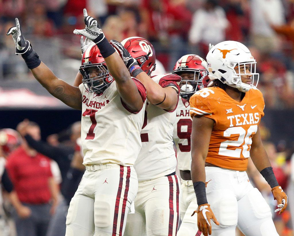 FILE - Oklahoma Sooners defensive end Ronnie Perkins (7) and his teammates celebrate his sack of Texas Longhorns quarterback Sam Ehlinger (not pictured) in the third quarter of the Big 12 Championship at AT&T Stadium in Arlington, Texas, Saturday, December 1, 2018. The Sooners defeated the Longhorns, 39-27. (Tom Fox/The Dallas Morning News)