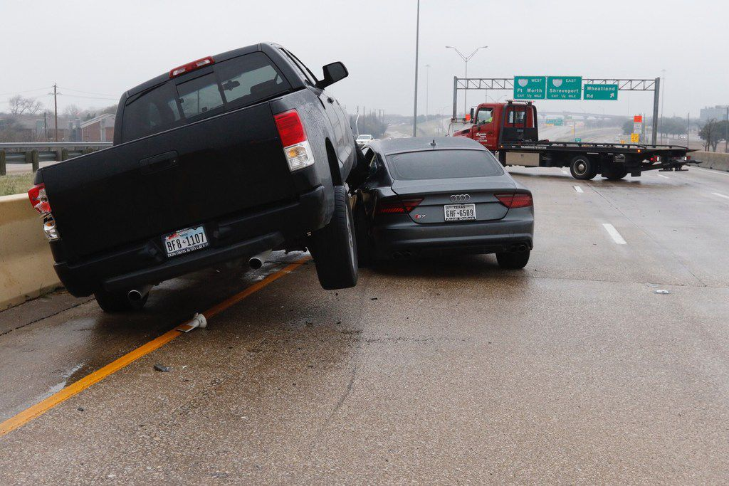 Richard Garay, of Express Towing, Inc. arrived at the scene of the wreck on the southbound lanes of Hwy. 67 over Camp Wisdom Road on February 28, 2019 in Dallas. Freezing temperature and wet conditions overnight led to icy roads, causing dozens of accidents.