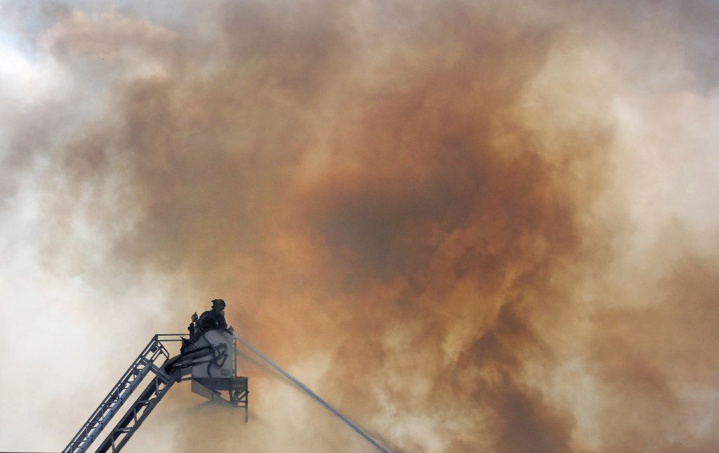 Firefighters battle a blaze at the Appleseed Academy in Mesquite on Wednesday, May 3, 2017. (Louis DeLuca/The Dallas Morning News)