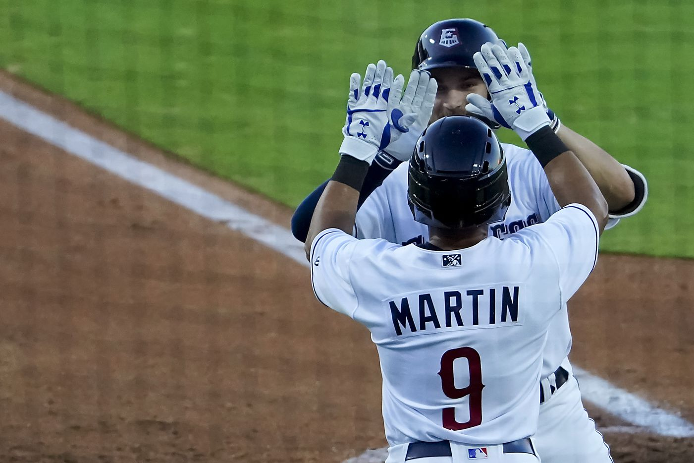 Round Rock Express infielder Charles Leblanc celebrates with outfielder Jason Martin after hitting a 2-run home run during the second inning against the Oklahoma City Dodgers at Dell Diamond on Thursday, May 6, 2021, in Round Rock, Texas.