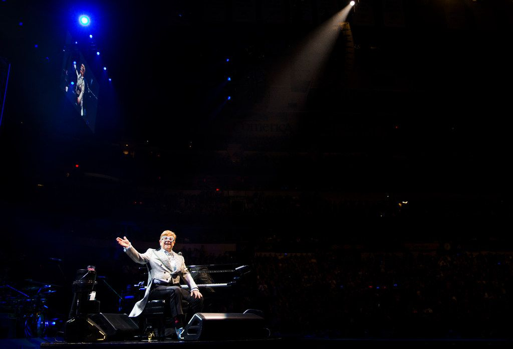 """Elton John performs """"Tiny Dancer"""" at American Airlines Center in Dallas on Friday, December 14, 2018 during his Farewell Yellow Brick Road tour. (Ashley Landis/The Dallas Morning News)"""