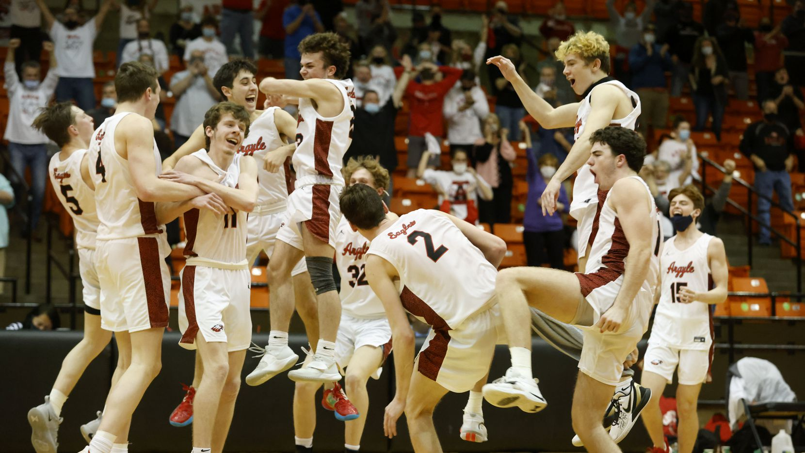 Argyle players celebrate their 43-39 victory over Oak Cliff Faith Family during a boys basketball Class 4A state semifinal in Fort Worth, Texas on March 9, 2021.