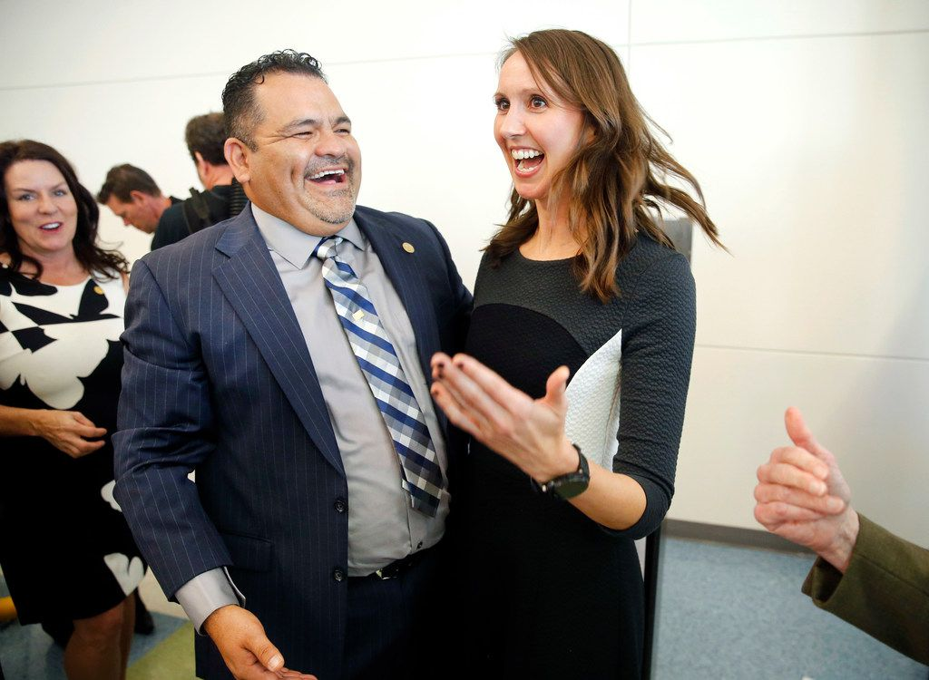 Arlington Collegiate High School teacher Jennifer Fuller (right) is congratulated on winning the coveted Milken Educator Award by former recipient Rogelio Garcia of Adelfa Callejo Elementary in Dallas following an assembly at the school in Arlington, Texas, Wednesday, October 18, 2017. Forty five educators across the country received the award this year, two in Texas. (Tom Fox/The Dallas Morning News)