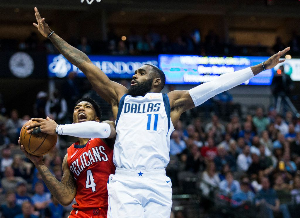 Dallas Mavericks guard Tim Hardaway Jr. (11) defends against New Orleans Pelicans guard Elfrid Payton (4) during the fourth quarter of an NBA game between the Dallas Mavericks and the New Orleans Pelicans on Monday, March 18, 2019 at American Airlines Center in Dallas. (Ashley Landis/The Dallas Morning News)