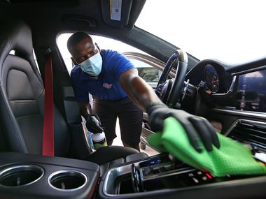 At Tommy Terrific's Car Wash in Plano, a worker cleans a vehicle while wearing a mask to prevent spread of the coronavirus. A surge in COVID-19 cases threatens a nascent recovery in jobs in Texas.
