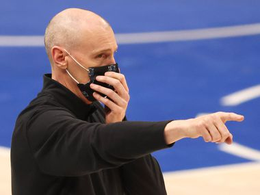 Dallas Mavericks head coach Rick Carlisle communicates to his players in a game against the Denver Nuggets during the third quarter of play at American Airlines Center on Monday, January 25, 2021in Dallas.