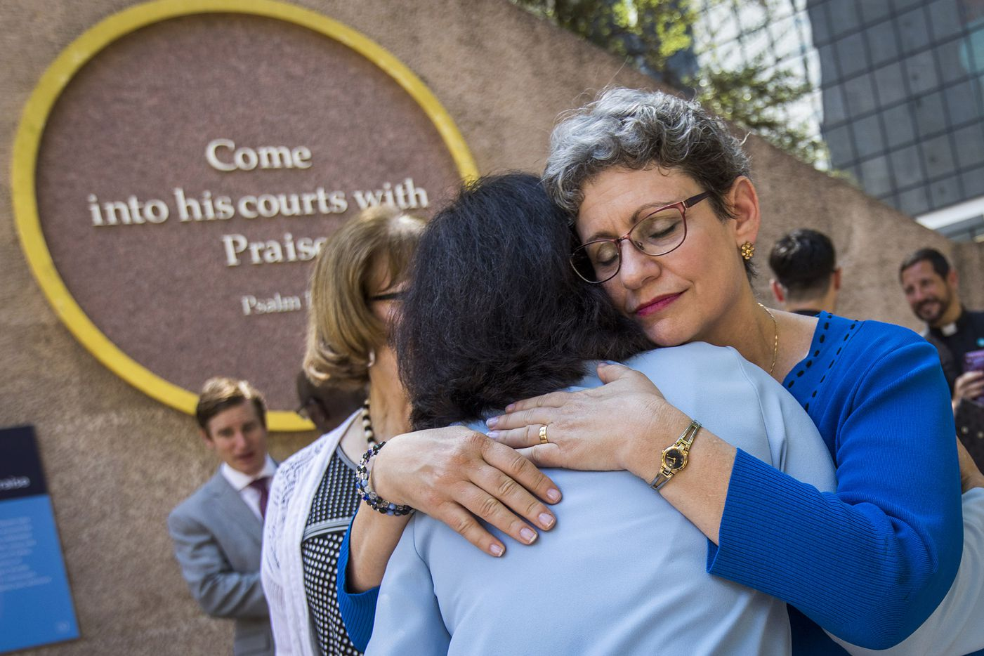 Linda Abramson Evans hugs Almas Muscatwalla during a day of remembrance for last year's police ambush organized by Faith Forward Dallas at Thanks-Giving Square on Friday, July 7, 2017, in Dallas.