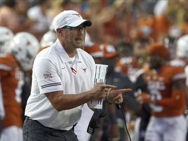 FILE - In this Sept. 12, 2020, file photo, Texas head coach Tom Herman shouts to his team during the first half of an NCAA college football game against UTEP in Austin, Texas. Texas' Herman and Baylor's Dave Aranda are old friends and college teammates who will meet for the first time Saturday, Oct. 24, 2020, as opposing head coaches. (AP Photo/Chuck Burton, File)