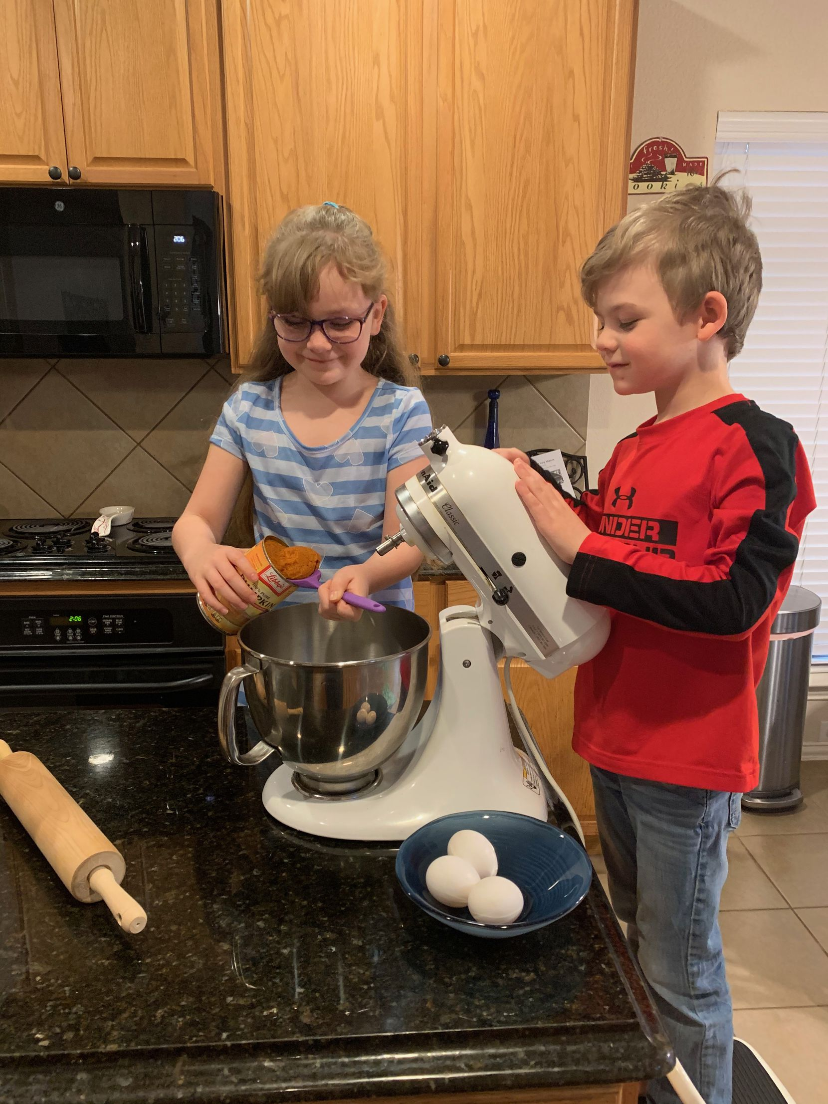 Lily Romito, 8, and Luca Romito, 6, prepare homemade dog biscuits to sell at Maggie's Barkery. The siblings plan to donate all profits to Operation Kindness of North Dallas.