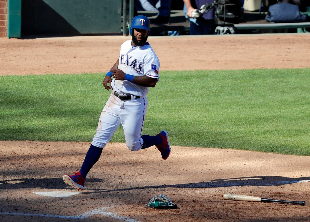 Texas Rangers' Danny Santana crosses home plate on a single by Delino DeShields in the eighth inning of a baseball game against the Oakland Athletics in Arlington, Texas, Sunday, April 14, 2019. The run was the go-ahead for the Rangers in their win. (AP Photo/Tony Gutierrez)