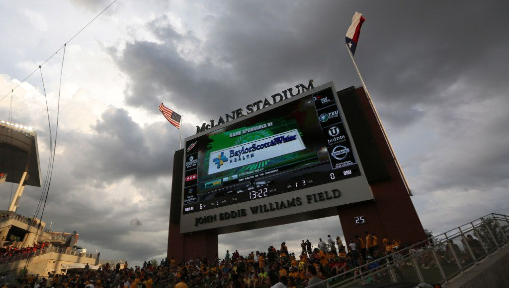Dark clouds loom over the stadium after nearby thunder caused a weather delay during the first quarter of an NCAA college football game between Oklahoma State and Baylor, Saturday, Sept. 24, 2016, in Waco, Texas. (AP Photo/LM Otero)