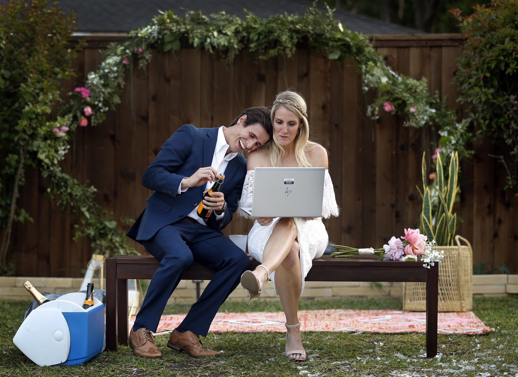 After their backyard wedding, the Houshians joined extended family and friends on a video chat as they popped champagne to celebrate.