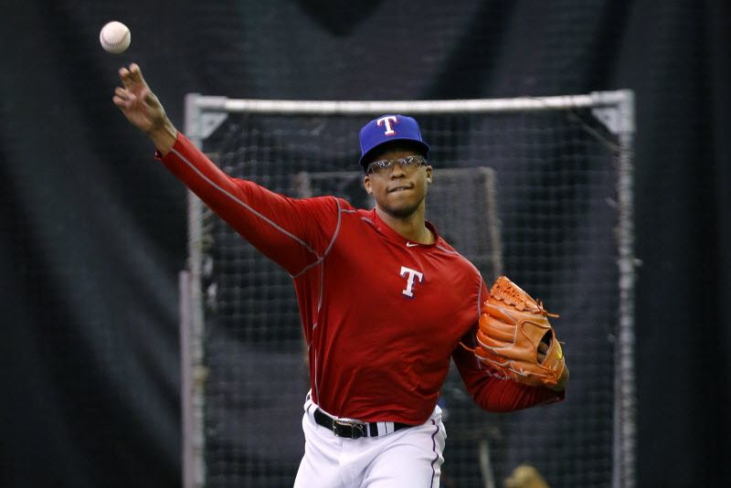Pitcher Dillon Tate throws in their indoor workout area  of Globe Life Park in Arlington during the Texas Rangers winter minicamp in Arlington, Texas, Thursday, January 21, 2016.