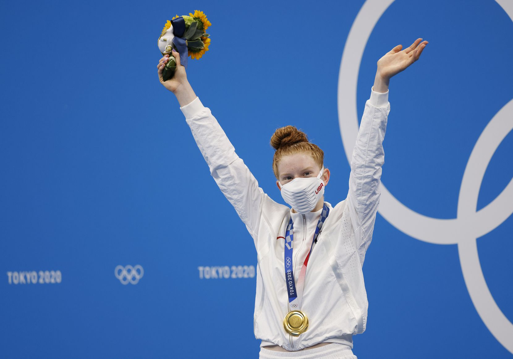 USA's Lydia Jacoby celebrates after receiving her gold medal during the medal ceremony for the women's 100 meter breaststroke final during the postponed 2020 Tokyo Olympics at the Tokyo Aquatics Center on Tuesday, July 27, 2021, in Tokyo, Japan. Jacoby won with a time of 1:04.95 to take gold. (Vernon Bryant/The Dallas Morning News)