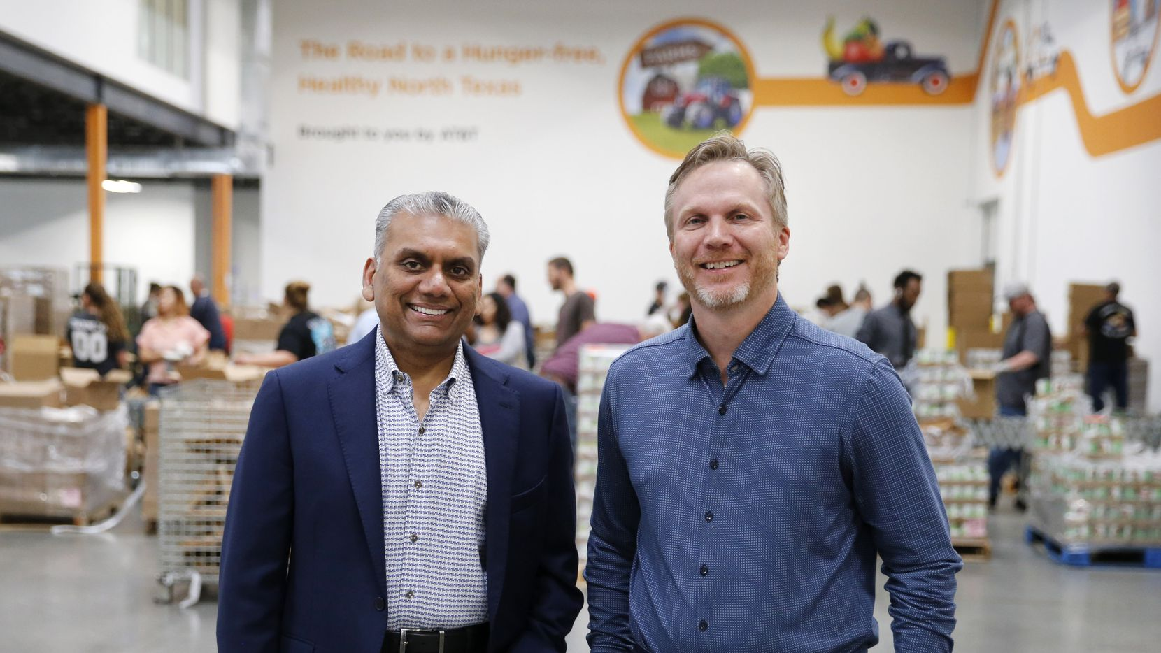 Anurag Jain, chairman of the North Texas Food Bank, is shown with Shiftsmart president Patrick Brandt at North Texas Food Bank in Plano.