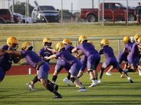 Linesmen run through a drill during the first day of high school football practice for 4A's Farmersville High School in Farmersville, Texas on Monday, August 3, 2020.