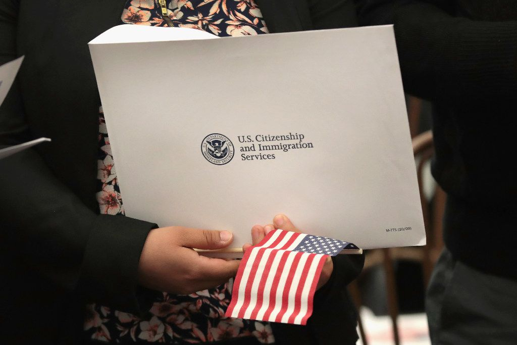 CHICAGO, IL - MAY 05:  People attend a naturalization ceremony on May 5, 2017 in Chicago, Illinois. Eight people, all of whom immigrated from Mexico, were sworn in as U.S. citizens at the ceremony.  (Photo by Scott Olson/Getty Images)