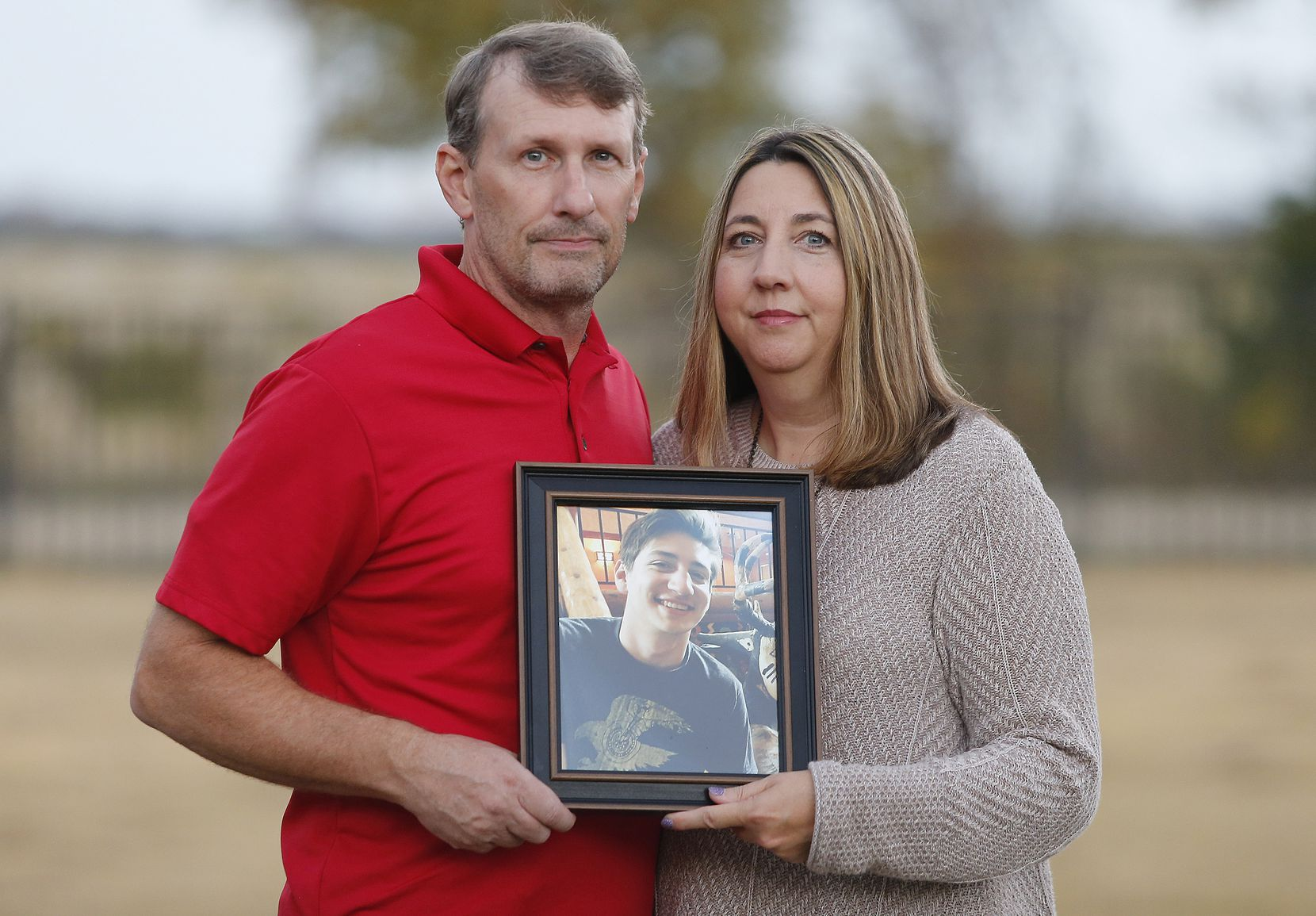 Bruce and Wendy Tyler with a photo of their son, Christian, who struggled with depression and died by suicide in August 2016. It was Wendy Tyler who alerted the district to the Hope Squad initiative as a possible way to help other students.