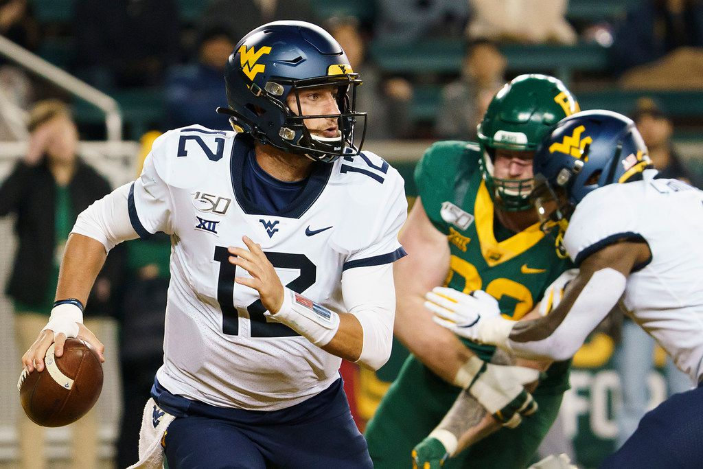 West Virginia quarterback Austin Kendall (12) scrambles away from the Baylor defense during the first half of an NCAA football game at McLane Stadium on Thursday, Oct. 31, 2019, in Waco, Texas. (Smiley N. Pool/The Dallas Morning News)