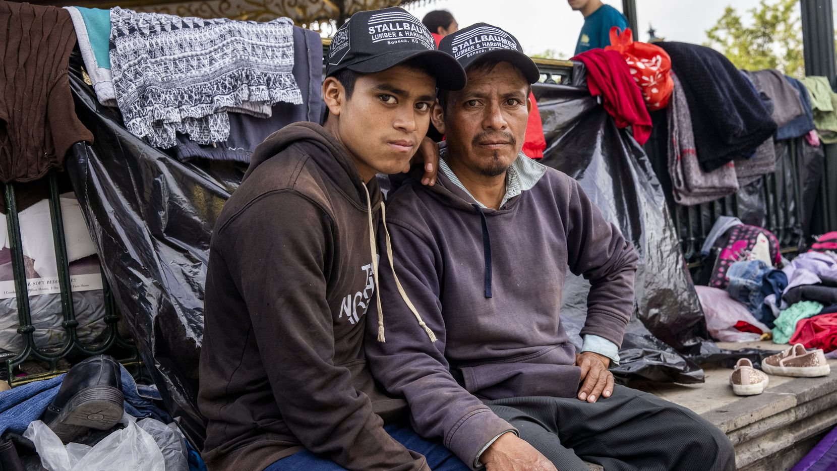 Guatemalan migrant Antulio Bamaca, right, and his 16-year-old son Everardo pose for a portrait from where they currently live at a gazebo in a public square in the Mexican border city of Reynosa on Wednesday, March 31, 2021. Expelled migrants have resorted to sleeping at the gazebo as the U.S. continues to implement Title 42 — a pandemic-related public order still in place and left over from the Trump administration.
