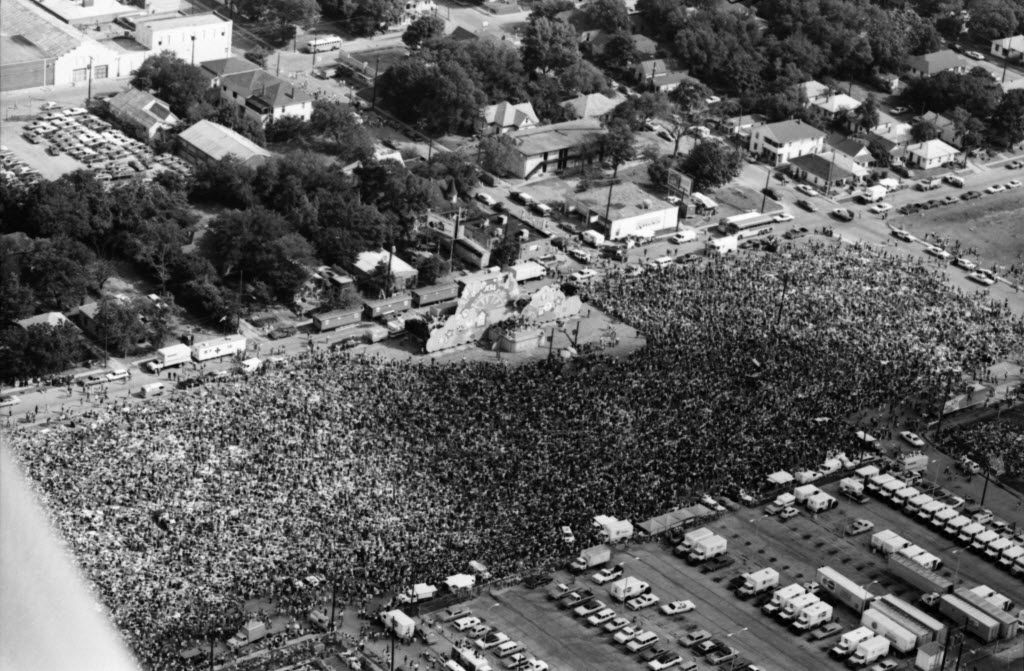 """This aerial of Woodall Rodgers Freeway was shot on June 17, 1972. According to Wikipedia: 1972 is seen as a pivotal year for Christian music festivals due to a crusade and evangelism training event called Explo '72, held in Dallas. Explo was sponsored by the World Conference on Missions and Campus Crusade for Christ. The weeklong event was attended by 80,000 registered attendees and concluded with a daylong music festival. The attendance of the final event was reported by Life magazine at 150,000 and was characterized by the Rev. Billy Graham as a """"religious Woodstock."""" The Explo '72 roster contained artists in a variety of genres, including performers Larry Norman, Love Song, Andrae Crouch, and Johnny Cash. Explo '72 was a watershed event for the fledgling Jesus Music genre, and was the most visible event of the Jesus People movement. It is also the largest Christian music festival ever recorded; some critics even credit Explo with jump-starting the Christian music industry."""