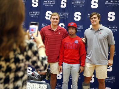 Fort Worth All Saints' Episcopal School offensive lineman Tommy Brockermeyer (right) and his twin brother James Brockermeyer (left) signed their national letters of intent with Alabama in the schools gymnasium, Wednesday, December 16, 2020. Joining them on National Signing Day was All Saints running back Montaye Dawson (SMU). (Tom Fox/The Dallas Morning News)