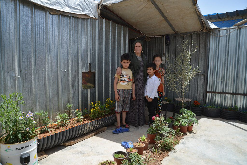A family in the Domiz refugee camp, where tents are being replaced with more permanent housing.