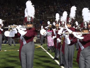 Members of the Plano Senior High School marching band are shown here in a screenshot of a performance video.