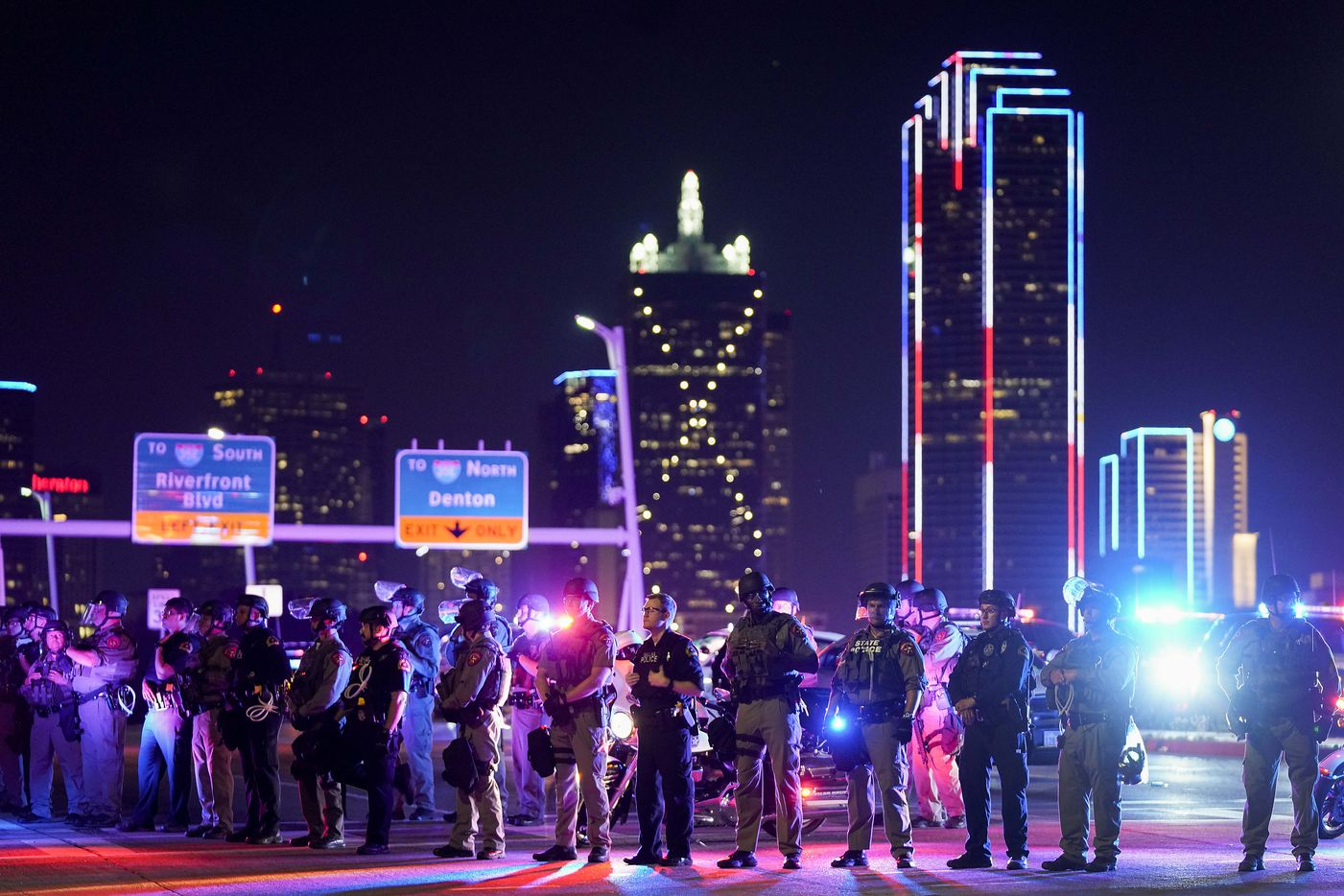 Law enforcement officers block the western side of the Margaret Hunt Hill Bridge while police conduct mass arrests on the bridge after protesters demonstrating against police brutality marched onto the bridge on Monday, June 1, 2020, in Dallas. Protests continued Monday, a week after the death of George Floyd.