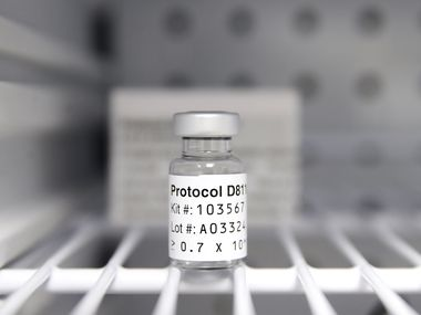 A sterile vial of AstraZeneca Phase III trial COVID vaccine sits in a refrigerator at the Prism Health North Texas location in Oak Cliff, Thursday, December 3, 2020. The clinic administers the vaccine to non-COVID patients participating in the trial study. (Tom Fox/The Dallas Morning News)