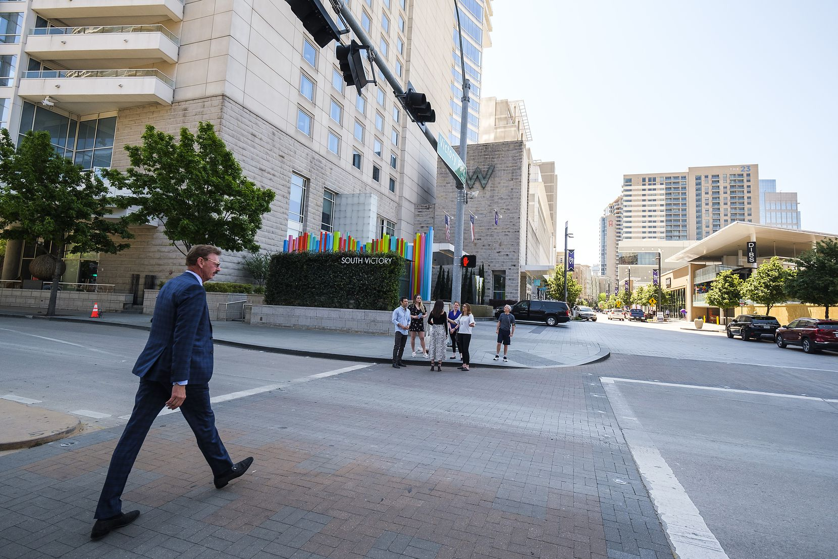 Victory Park president and owner Lothar Estein crosses Olive Street as he walks along Victory Park Lane after a ceremony marking the completion of the new retail street at Victory Park in Dallas.