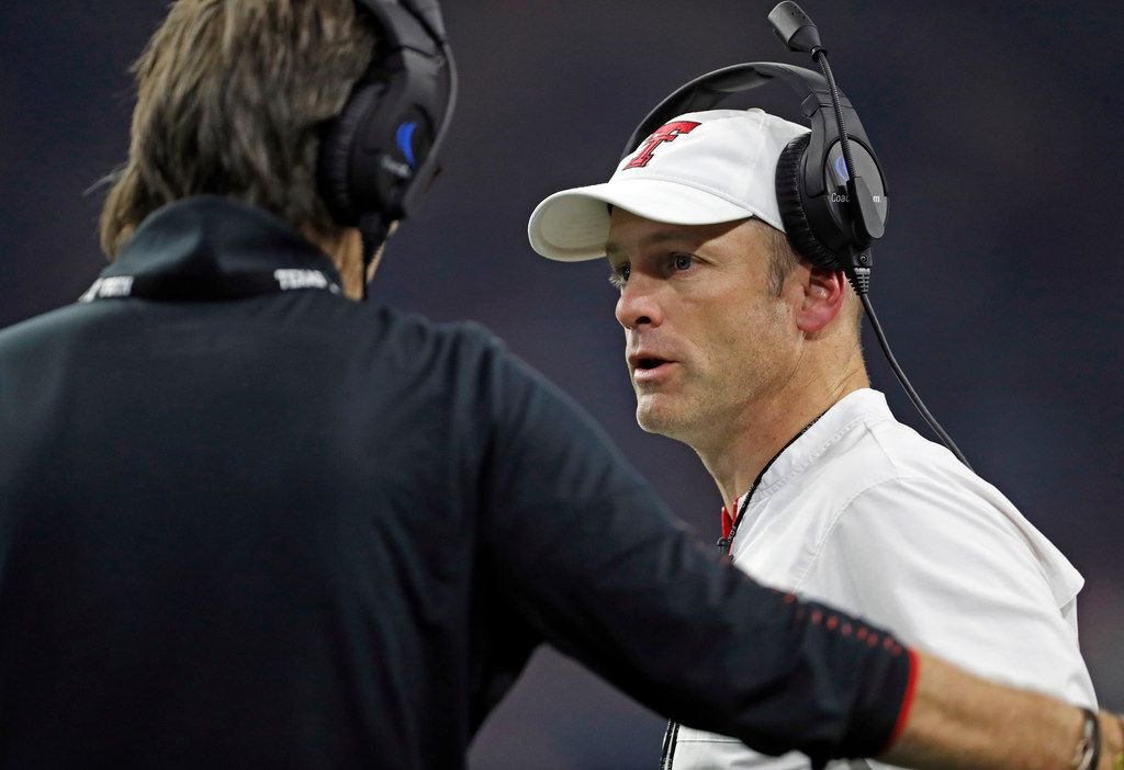 Texas Tech coach Matt Wells, right, talks to special teams coordinator Mark Tommerdahl during an NCAA college football spring game, Saturday, April 13, 2019, in Frisco, Texas. (Brad Tollefson/Lubbock Avalanche-Journal via AP)
