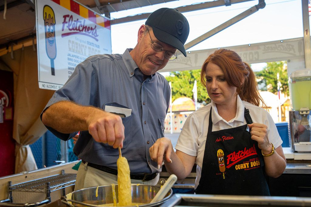 Amber Fletcher (right) teaches Dallas Morning News subscriber Sam Taylor how to fry a Fletcher's corny dog during a TDMN members event at Fair Park in Dallas.