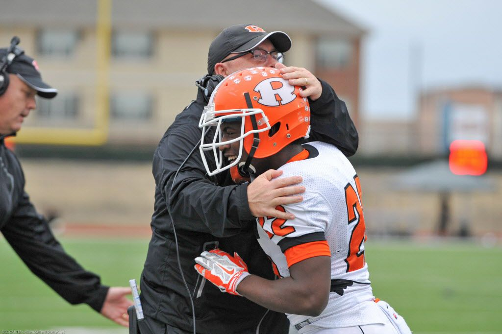 Rockwall coach Rodney Webb congratulates A.J. Blacknall (22) after a 48-27 win over Jesuit.