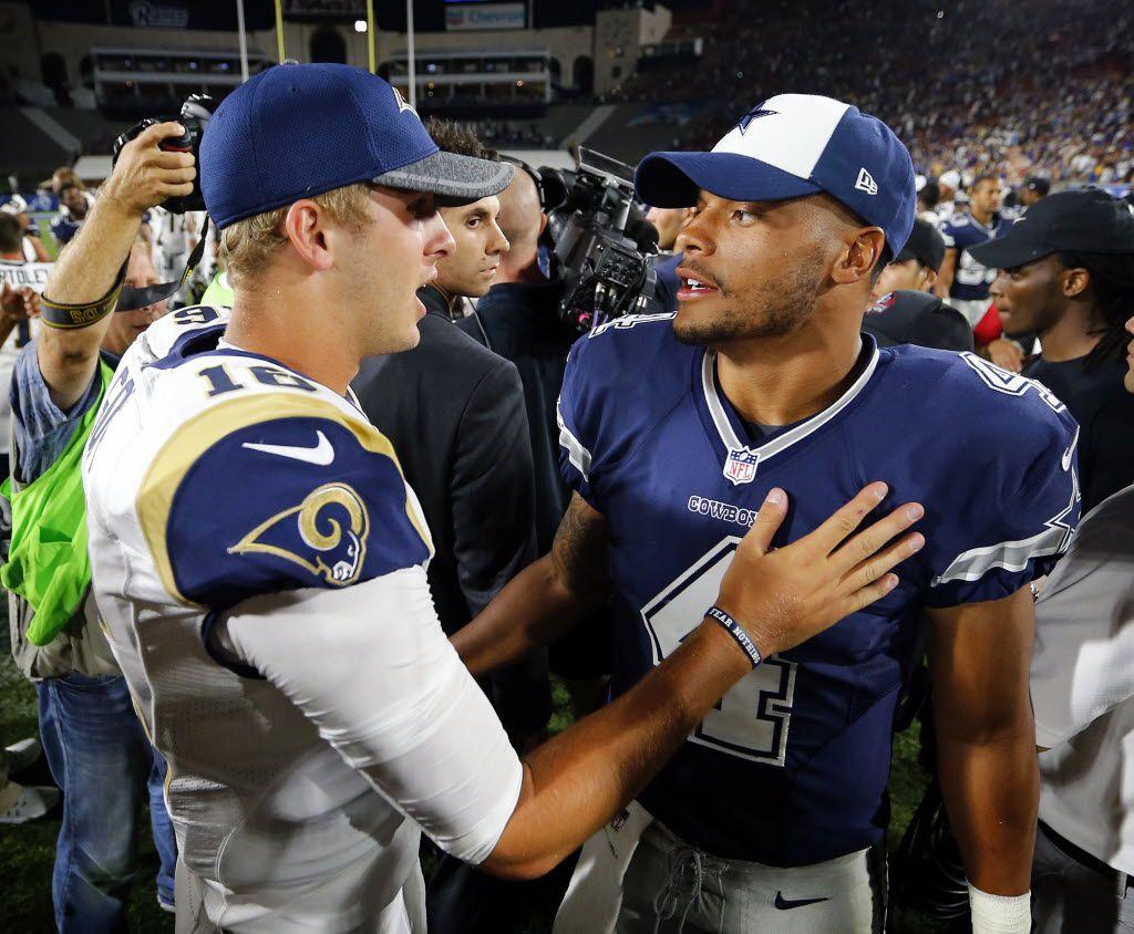 Dallas Cowboys quarterback Dak Prescott (4) and Los Angeles Rams quarterback Jared Goff (16) visit following their first preseason game at the Los Angeles Memorial Coliseum, Saturday, August 13, 2016. The Cowboys lost 28-24,
